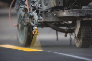 Parking striping with thermoplastic paint