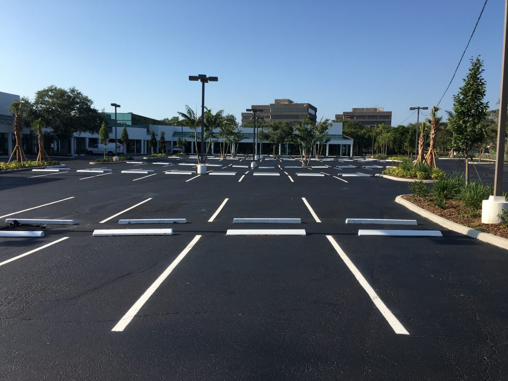 Parking lot spaces with thermoplastic paint
