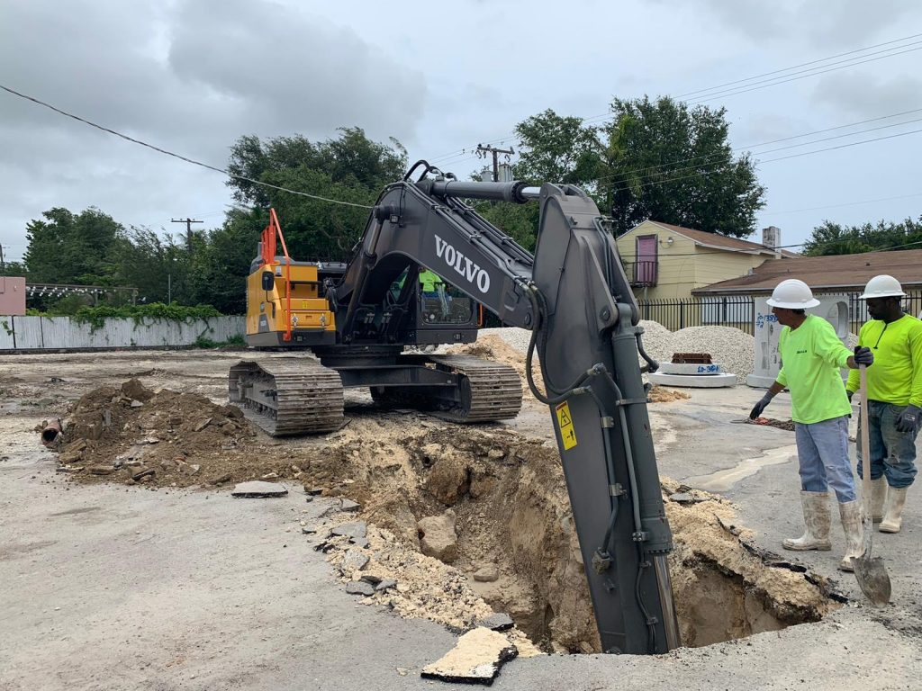 Excavator removing dirt in order to proceed with Drainage process.