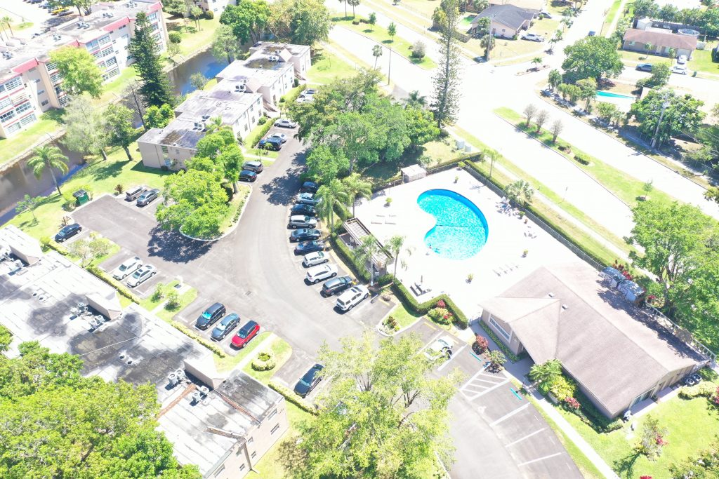 Recently milled and paved parking lot beside a pool in Margate, Florida by All Paving Inc.