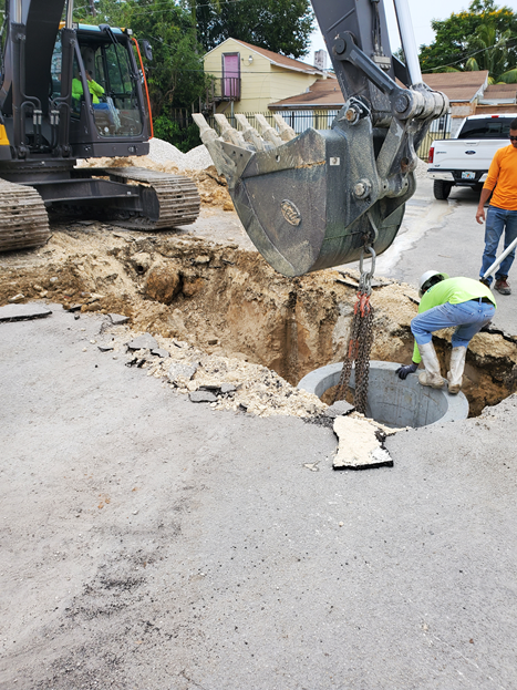 Retro Excavator Installing A Catch Basin In A Driveway Project