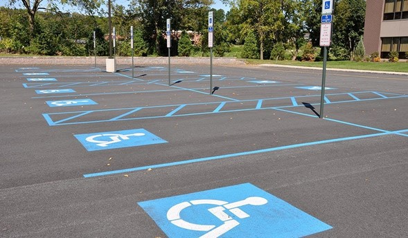 Empty Handiccaped Parking Lot With Blue Stripes